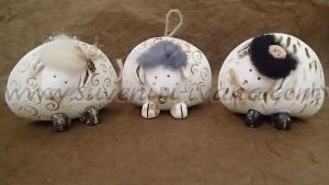 Ceramic  sheep with handmade decoration 8.5 x 7.0 cm.